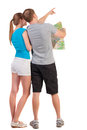 Back view journey young couple looking map travelers men women shorts consider recreation rear view people collection husband wife Royalty Free Stock Photography