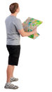 Back view of journey young man looking at the map travelers man in shorts consider recreation lost hiker rear view people Stock Image