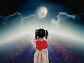 Back view of lonely child with doll sad gesture on pathway with Royalty Free Stock Photo
