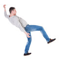 Back view man Balances waving his arms. Royalty Free Stock Photo