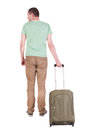 Back view of man with green suitcase looking up rear people collection backside person isolated over white background Stock Photo