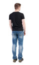 Back view of man in jeans standing young guy rear people collection backside person isolated over white background Royalty Free Stock Image