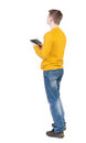 Back view of man with tablet standing young guy rear people collection backside person isolated over white background Royalty Free Stock Photos