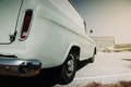 Back view of an old wagon parked at the aerodrome vintage retro van car in Royalty Free Stock Photo