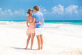 Back view photo of couple in bright clothes on tropical beach tulum this image has attached release Royalty Free Stock Image