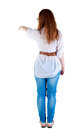Back view of pointing beautiful redhaired  woman . Royalty Free Stock Photo