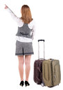 Back view of pointing business woman with suitcase looking up rear people collection backside person isolated over Royalty Free Stock Image