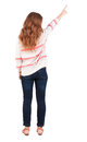 Back view of pointing woman beautiful redhaired girl girl shows something to someone rear people collection backside Royalty Free Stock Images