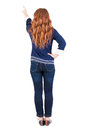Back view of pointing woman beautiful redhaired girl girl shows something to someone rear people collection backside Royalty Free Stock Photography