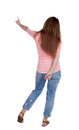 Back view of  pointing woman. Royalty Free Stock Photo
