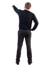 Back view of pointing young business man in black sweater blonde businessman gestures rear view people collection backside view of Royalty Free Stock Images