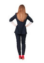 Back view of redhead business woman contemplating young girl in suit rear people collection backside person isolated Royalty Free Stock Photos