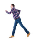 Back view of running man in checkered shirt walking guy motion rear people collection backside person isolated Stock Image