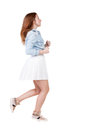 Back view of running woman beautiful redhead girl in motion backside person rear people collection isolated over Royalty Free Stock Image