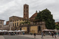 Back view of San Giovanni Church and Sunday market on Piazza San Martino. Lucca. Italy. Royalty Free Stock Photo