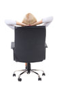 Back view of satisfied business woman with hands crossed behind her head sitting on office chair isolated on white background Royalty Free Stock Photos