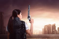 Back view of asian woman using police uniform with gun Royalty Free Stock Photo