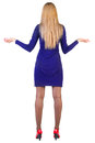 Back view of shocked business woman in blue dress. Stock Photos