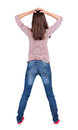 Back view of shocked woman in blue jeans. Royalty Free Stock Photo