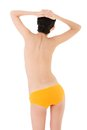 Back view of slim woman in yellow lingerie Royalty Free Stock Photo
