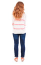 Back view of standing redhead woman young beautiful teenage girl in jeans and a sweater thoughtfully looks sideways rear Royalty Free Stock Photos