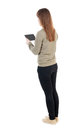 Back view of standing young beautiful  girl with tablet computer Royalty Free Stock Photo