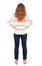 Back view of standing young beautiful redhead woman girl watching rear people collection backside person isolated Royalty Free Stock Photo