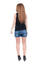 Back view of standing young beautiful redhead woman girl watching rear people collection backside person isolated Stock Photo