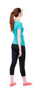 Back view of standing young beautiful  woman. girl  watching. Royalty Free Stock Photo