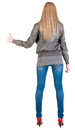 Back view of standing young blonde woman showing thumb up Royalty Free Stock Photo