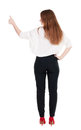 Back view of standing young redhead business woman showing thumb