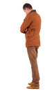Back view of stylishly dressed man in a brown jackett  looking u Stock Image