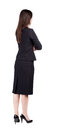 Back view of thoughtful business woman contemplating young girl in suit rear people collection backside person Royalty Free Stock Photos