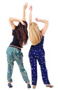 Back view of two beautiful young woman dancing Stock Images