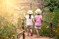 Back view of two little girls holding hand and walking together Royalty Free Stock Photo