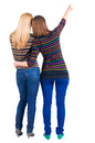 Back view of two young  brunette woman pointing Stock Photo