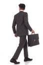 Back view of a walking businessman with briefcase Royalty Free Stock Photo