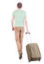Back view of walking man with suitcase brunette guy in motion backside person rear people collection isolated over Stock Images