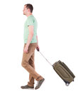 Back view of walking man with suitcase brunette guy in motion side person rear people collection isolated over white Stock Photos