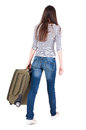 Back view of walking woman with suitcase beautiful brunette girl in motion backside person rear people collection Stock Photos