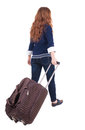 Back view of walking woman with suitcase beautiful redhead girl in motion backside person rear people collection Stock Photography