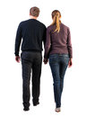 Back view of walking young couple man and woman going beautiful friendly girl and guy in shorts together rear view people Royalty Free Stock Photo