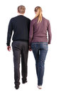 Back view walking young couple man woman young husband wife autumn clothes walk going beautiful friendly girl guy shorts together Stock Photos