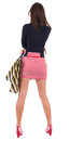 Back view of woman  in  dress  with shopping bags Royalty Free Stock Images