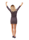 Back view of  woman raise your hands up expressing joy. Royalty Free Stock Photo