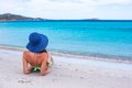 Back view of woman relaxing at tropical beach young beautiful white sand Stock Photography