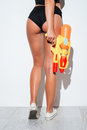 Back view of women butt in bikini and water gun Royalty Free Stock Photo