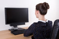 Back view of young beautiful business woman using pc with empty Royalty Free Stock Photos