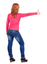 Back view of young beautiful woman  going thumb up. Royalty Free Stock Photo