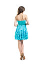 Back view of young beautiful woman in turquoise cocktail dress Royalty Free Stock Photo